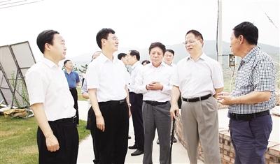 中残联副主席王新宪在我市调研王立伟等陪同